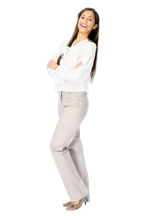 Businesswoman confident portrait of a hispanic woman with arms crossed isolated on white background in studio. photo