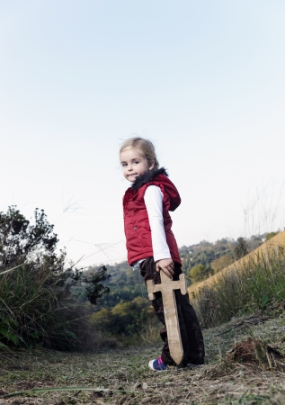young girl playing pretend explorer adventure game outdoors. cute young child having fun Stock Photo - 14900022