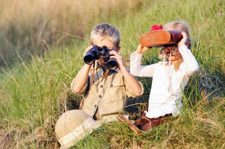 cute children playing pretend safari game together outdoors. happy brother and sister Stock Photo - 14874066