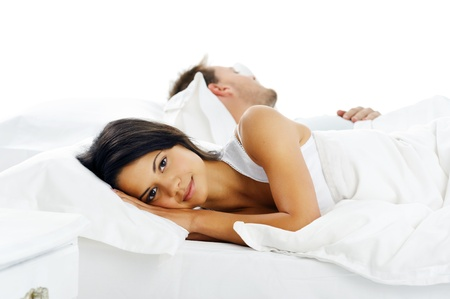 arguement: couple in bed facing away from each other after arguement. relationship issues
