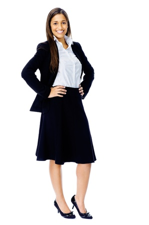 Full length portrait of a confident businesswoman in a suit and heels isolated on white background photo