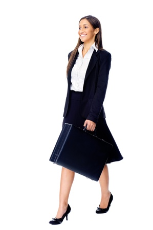 Businesswoman wearing suit walking with briefcase isolated on white background photo