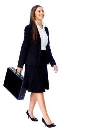 Businesswoman wearing suit walking with briefcase isolated on white background Stock Photo - 15291432