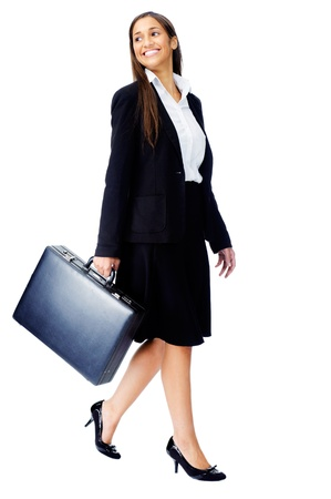 Businesswoman wearing suit walking with briefcase isolated on white background Stock Photo - 15291427