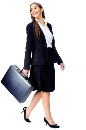 Businesswoman wearing suit walking with briefcase isolated on white background Stock Photo - 15291433