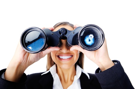 job searching: Portrait  of a businesswoman searching for new job opportunities with binoculars. can also be used as business vision concept