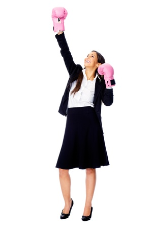 Successful competitive businesswoman is happy and and has boxing gloves while wearing a suit and isolated on white background Stock Photo - 15282831