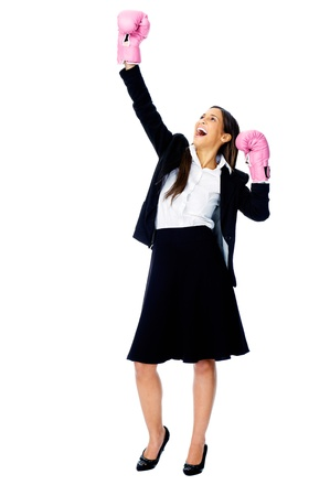 Successful competitive businesswoman is happy and and has boxing gloves while wearing a suit and isolated on white background Stock Photo - 15282828