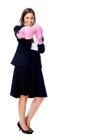 Successful competitive businesswoman is happy and and has boxing gloves while wearing a suit and isolated on white background photo