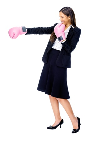 Successful competitive businesswoman is happy and and has boxing gloves while wearing a suit and isolated on white background Stock Photo - 15291339
