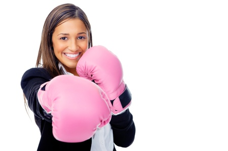strong girl: Successful competitive businesswoman is happy and and has boxing gloves while wearing a suit and isolated on white background