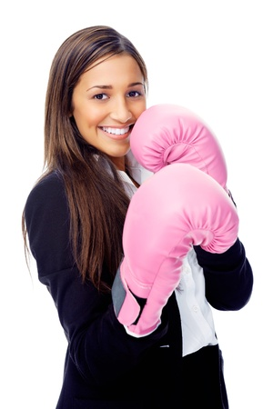female boxer: Successful competitive businesswoman is happy and and has boxing gloves while wearing a suit and isolated on white background