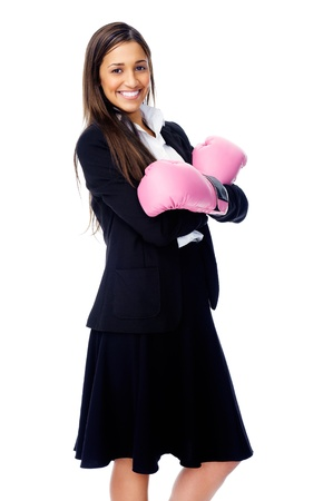 Successful competitive businesswoman is happy and and has boxing gloves while wearing a suit and isolated on white background Stock Photo - 15291438