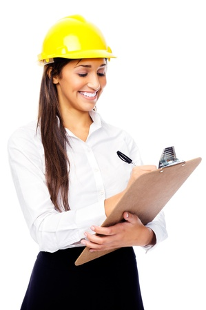 engineering clipboard: Businesswoman with safety helmet hardhat and clipboard for surveying construction industry isolated on white background