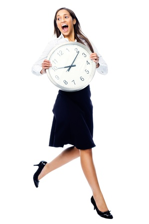 worried executive: Time running away concept with businesswoman holding clock and jumping isolated on white background