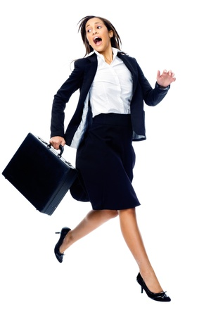 Businesswoman in a hurry rushing and running with briefcase isolated on white background Stock Photo - 15291350