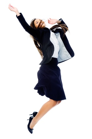 Carefree celebrating businesswoman jumping with joy, victory and happiness while smiling in a suit isolated on white background Stock Photo - 15291338