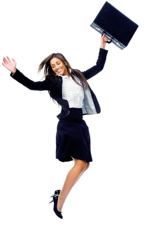 Carefree celebrating businesswoman jumping with joy, victory and happiness while smiling in a suit isolated on white background Stock Photo - 15291342