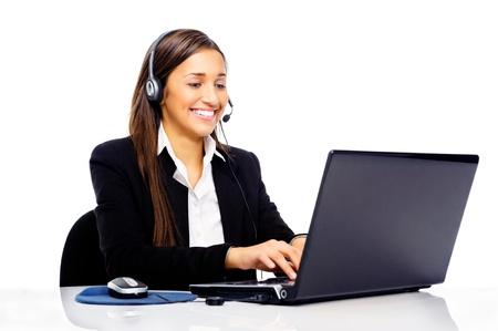 call center agent: Amichevole call center segretaria consulente donna con telefono auricolare e bel sorriso Archivio Fotografico