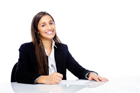 Confident happy businesswoman signing contract at her desk isolated on white background Stock Photo - 15291553