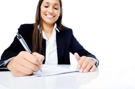 Confident happy businesswoman signing contract at her desk isolated on white background Stock Photo - 15291537