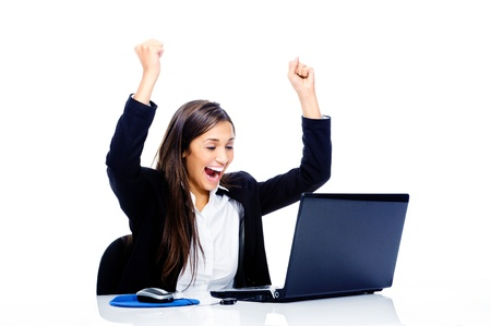 euphoric: Celebrating businesswoman at desk with laptop computer isolated on white background
