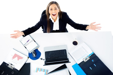 overwhelmed businesswoman is stressed and overworked at her desk office job photo