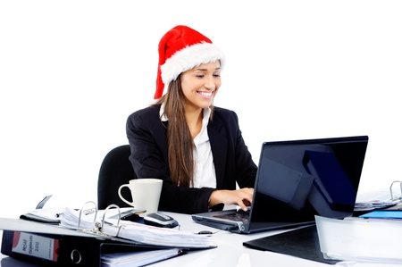Christmas business woman celebrating the end of work year with a xmas hat at the office Stock Photo - 15291550