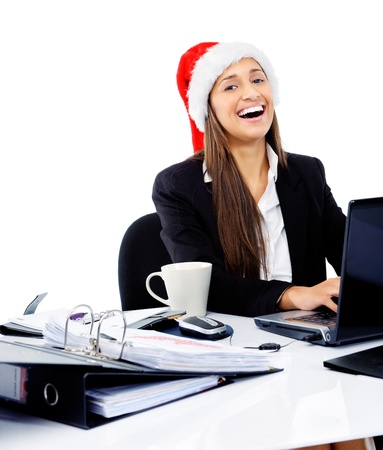 secretary office: Christmas business woman celebrating the end of work year with a xmas hat at the office Stock Photo