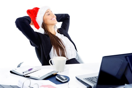 business christmas: Christmas business woman daydreaming at her desk isolated on white background