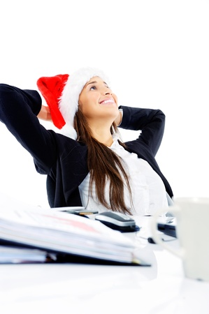 Christmas business woman daydreaming at her desk isolated on white background Stock Photo - 15291547