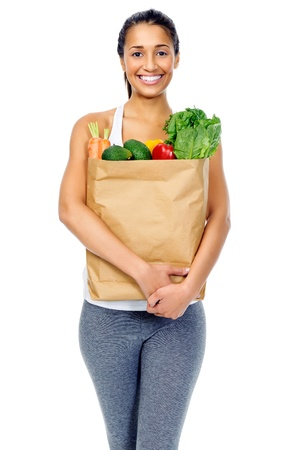 Healthy positive happy woman with paper shopping bag full of organic fruit and vegetables Stock Photo