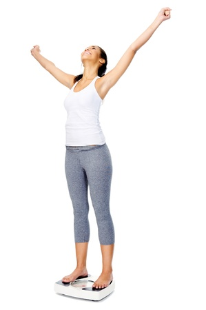weight machine: Woman with scale celebrating weightloss and a healthy fit body