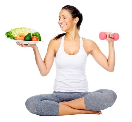 食事と運動、健康的なライフ スタイルの女性の白い背景で隔離