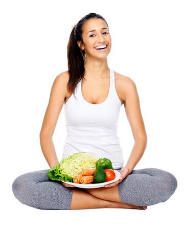 woman healthy: Vegetarian woman sitting with plate of vegan friendly vegetables  healthy eating and diet concept Stock Photo