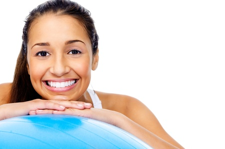 Portrait of fit and healthy gym woman with ball isolated on white background, smiling and happy  photo