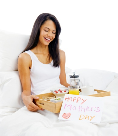 Happy mothers day breakfast in bed mum with card and tray of delicious food Stock Photo - 15981301
