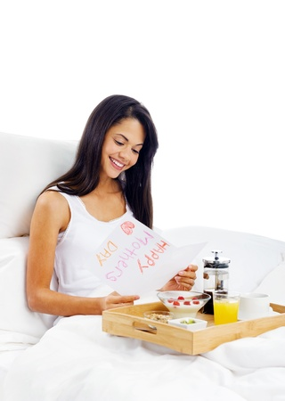 Happy mothers day breakfast in bed mum with card and tray of delicious food Stock Photo - 15981311