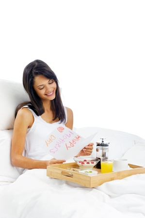 Happy mothers day breakfast in bed mum with card and tray of delicious food Stock Photo - 15981313
