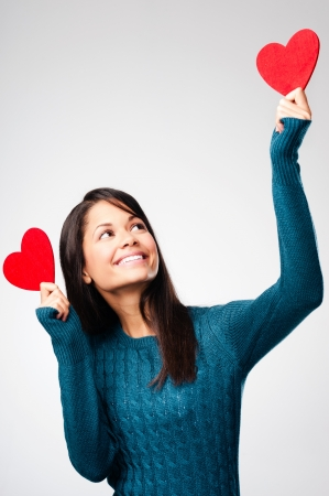 adorable girl with valentines day heart showing love fun affection portrait on grey background Stock Photo - 16109187