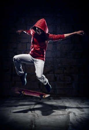 skateboard: Skateboarder doing trick with grunge background red hoodie and skill