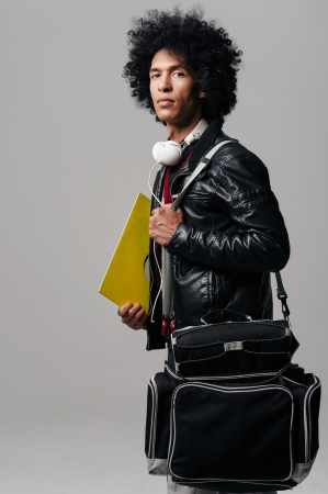 Music dj portrait with afro and headphones isolated on grey background Stock Photo - 16437091