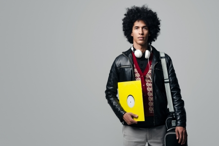 Music dj portrait with afro and headphones isolated on grey background photo