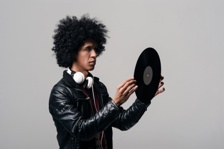 retro music dj portrait with old vinyl record photo