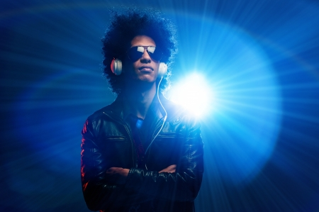 Cool nightclub party dj portrait with headphones lighting flare and sunglasses Stock Photo - 16494749