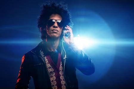 Cool nightclub party dj portrait with headphones lighting flare and sunglasses Stock Photo - 16494751