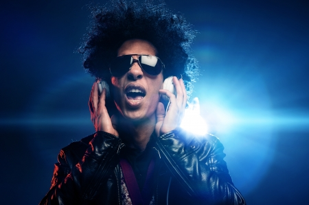 Singing dj with headphones in nightclub party scene and afro, lighting lens flare Stock Photo - 16494755