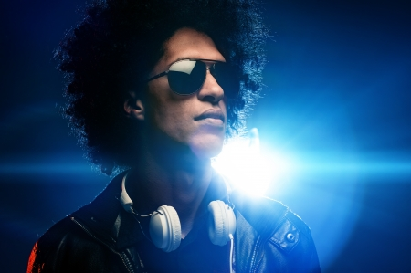 Cool nightclub party dj portrait with headphones lighting flare and sunglasses Stock Photo - 16494752