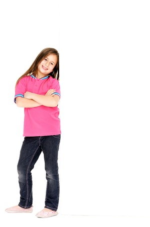 cute young girl standing next to empty blank board with copyspace Stock Photo - 16597251