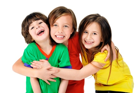 friend hug: cute adorable children having fun together with bright colorful t-shirts isolated on white background